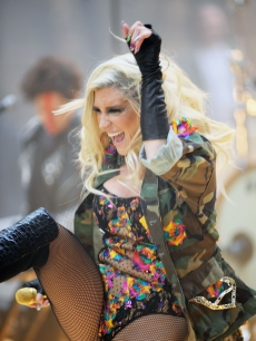 Ke$ha gets a kick out of her performance on NBC's 'Today' show at Rockefeller Plaza in New York City on November 20, 2012