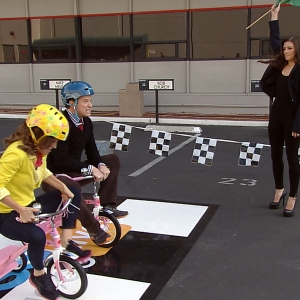 Billy Bush & Kit Hoover Race Tricycles With Danica Patrick Officiating!