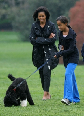 Michelle and Malia Obama are seen at the White House with Bo, their new Portuguese water dog, on April 14, 2009
