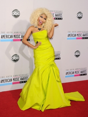 Nicki Minaj shines on the carpet in a bright in a yellow dress at the 40th American Music Awards at the Nokia Theatre on November 18, 2012 in Los Angeles 