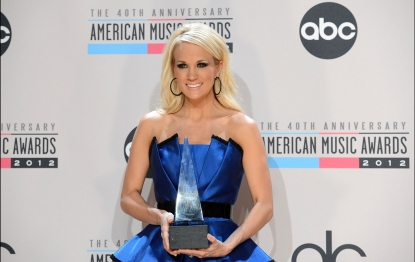 Carrie Underwood poses with the Favorite Country Music Album for 'Blown Away' in the press room at the 40th American Music Awards held at Nokia Theatre L.A. Live in Los Angeles on November 18, 2012