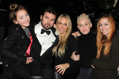 Billy Ray Cyrus poses with his family backstage at the hit musical 'Chicago' on Broadway at The Ambassador Theater in New York City on November 18, 2012