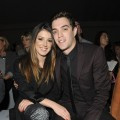 Shenae Grimes and Josh Beech attend the front row for the Unique show on day 3 of London Fashion Week Spring/Summer 2013 at TopShop Venue on September 16, 2012 in London