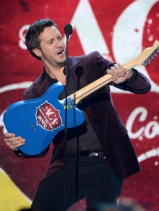Luke Bryan accepts the Artist of the Year award onstage during the 2012 American Country Awards at the Mandalay Bay Events Center, Las Vegas, on December 10, 2012