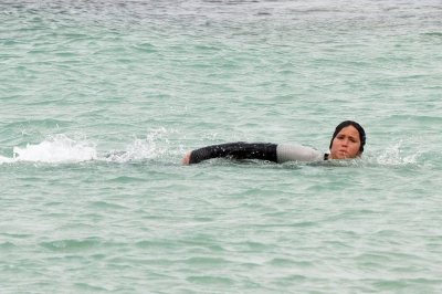 Jennifer Lawrence jumps in the water while filming 'The Hunger Games: Catching Fire' in Hawaii on November 26, 2012