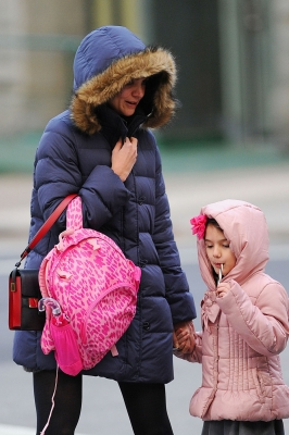 Katie Holmes and daughter Suri Cruise bundle up in big puffy winder coats as they head home from school in New York City on December 11, 2012