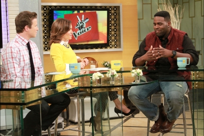 Billy Bush and Kit Hoover chat with 'The Voice' contestant Trevin Hunte on Access Hollywood Live, December 5, 2012