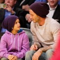 David Beckham and his son Romeo attend a basketball game between the Oklahoma City Thunder and the Los Angeles Lakers at Staples Center on March 29, 2012 in Los Angeles