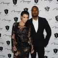 A pregnant Kim Kardashian hits the red carpet with Kanye West for a New Year's Eve bash at 1 OAK Nightclub at the Mirage on December 31, 2012 in Las Vegas