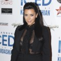 Hot mama-to-be! Kim Kardashian steps out in a revealing black ensemble to host ICED at Cowboys Dance Hall in Calgary, Canada on January 4, 2013