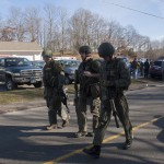 Connecticut State Police walk near the scene of an elementary school shooting on December 14, 2012 in Newtown, Connecticut