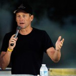 Cyclist Lance Armstrong addresses participants at The LIVESTRONG Challenge Ride at the Palmer Events Center on October 21, 2012