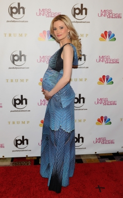 Holly Madison shows off her baby bump at the 2012 Miss Universe Pageant at Planet Hollywood Resort & Casino in Las Vegas on December 19, 2012