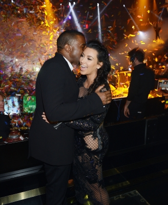 Kanye West plants a kiss on Kim Kardashian inside Mirage's 1 OAK nightclub as the clock hits midnight on December 31, 2012