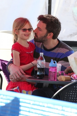 Awww! Ben Affleck leans in to give daughter Violet a kiss on the cheek at an ice rink in Santa Monica, Calif., on January 4, 2013