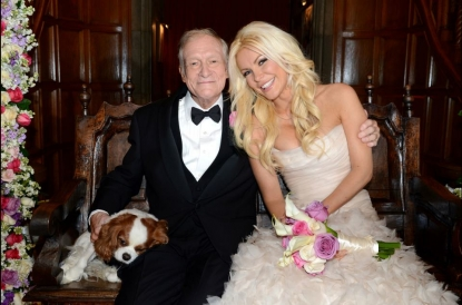 Hugh Hefner and Crystal Harris pose for photos following their wedding at the Playboy Mansion on December 31, 2012