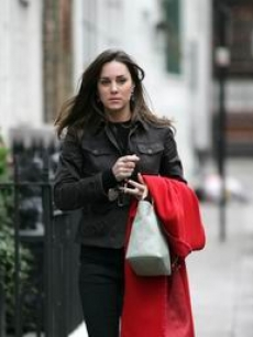 Kate Middleton, gf of Britain's Prince William, walks in London