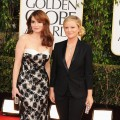 Hosts Tina Fey and Amy Poehler arrive at the 70th Annual Golden Globe Awards held at The Beverly Hilton Hotel on January 13, 2013