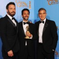 Ben Affleck, producer Grant Heslov and producer George Clooney, winners of Best Motion Picture (Drama) for &#8216;Argo,&#8217; poses in the press room backstage at the 2013 Golden Globes