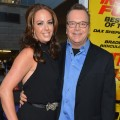 Ashley Groussman and Tom Arnold arrive to the premiere of Open Road Films' 'Hit and Run' on August 14, 2012 in Los Angeles
