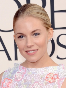 Sienna Miller arrives at the 70th Annual Golden Globe Awards held at The Beverly Hilton Hotel on January 13, 2013