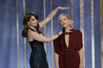 Tina Fey and Amy Poehler host the 70th Annual Golden Globe Awards at the Beverly Hilton Hotel International Ballroom on January 13, 2013