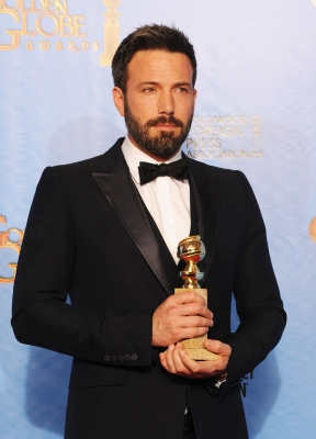 Ben Affleck, winner of Best Director, poses in the press room during the 70th Annual Golden Globe Awards held at The Beverly Hilton Hotel on January 13, 2013