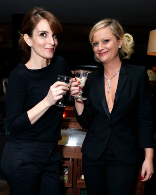 Tina Fey and Amy Poehler toast with Baileys at a private after party following the Golden Globes on January 14, 2013 in  Beverly Hills