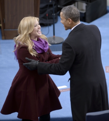 President Barack Obama greets singer Kelly Clarkson after Obama took the oath of office during the 57th Presidential Inauguration ceremonial swearing-in at the US Capitol on January 21, 2013 in Washington, DC