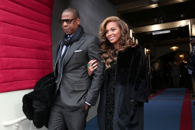 Jay-Z and Beyonce arrive at the presidential inauguration on the West Front of the U.S. Capitol January 21, 2013 in Washington, DC