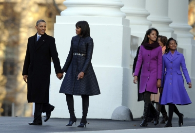President Barack Obama and First Lady Michelle Obama are joined by their daughters Sasha and Malia at the White House as they walk to the reviewing stand for the inaugural parade on January 21, 2013 in Washington,DC
