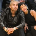 Chris Brown &amp; Rihanna get close during the Los Angeles Lakers/New York Knicks game on December 25, 2012 in Los Angeles
