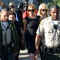 Lindsay Lohan her lawyer Mark Heller and her mother Dina leave Airport Courthouse after the pre-trial hearing on January 30, 2013 in Los Angeles
