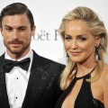 Martin Mica and Sharon Stone attend amfAR Milano 2012 during Milan Fashion Week at La Permanente on September 22, 2012 in Milan, Italy