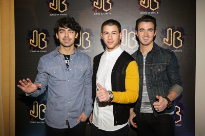 Joe Jonas, Nick Jonas and Kevin Jonas of the Jonas Brothers attend a press conference at W Hotel Mexico City on January 23, 2013 in Mexico City