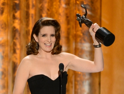 Tina Fey accepts the award for Outstanding Performance by a Female Actor in a Comedy Series for '30 Rock' onstage during the 19th Annual Screen Actors Guild Awards held at The Shrine Auditorium on January 27, 2013