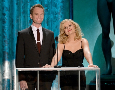Neil Patrick Harris and Amy Poehler speak onstage during the 19th Annual Screen Actors Guild Awards held at The Shrine Auditorium on January 27, 2013 (Photo by Getty Images)
