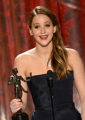 Jennifer Lawrence accepts the award for Outstanding Performance by a Female Actor in a Leading Role for 'Silver Linings Playbook' onstage during the 19th Annual Screen Actors Guild Awards held at The Shrine Auditorium on January 27, 2013 (Photo by Getty Images)