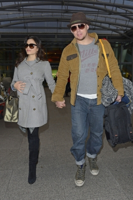 Jenna Dewan-Tatum and Channing Tatum arrive at Heathrow Airport in London on February 9, 2013