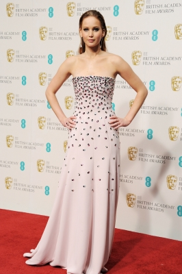 Jennifer Lawrence poses in the Press Room at the EE British Academy Film Awards at The Royal Opera House on February 10, 2013 in London