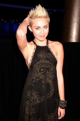 Miley Cyrus attends the Clive Davis and The Recording Academy's 2013 GRAMMY Salute to Industry Icons Gala held at The Beverly Hilton Hotel on February 9, 2013