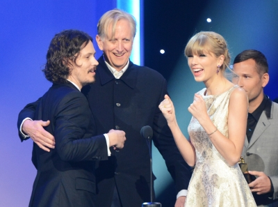 Musician John Paul White, producer T Bone Burnett, and Taylor Swift accept an award onstage during the 55th Annual Grammy Awards at Nokia Theatre L.A. Live, Los Angeles, on February 10, 2013