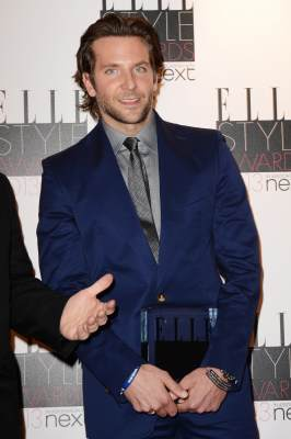 Bradley Cooper poses with his Best Actor Award in the press room at The Elle Style Awards 2013 at The Savoy Hotel on February 11, 2013 in London, England