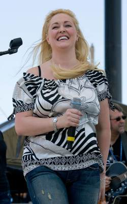 Mindy McCready performs at the Greased Lightning Daytime Stages during the 2008 CMA Music Festival on June 5, 2008 at Riverfront Park in Nashville