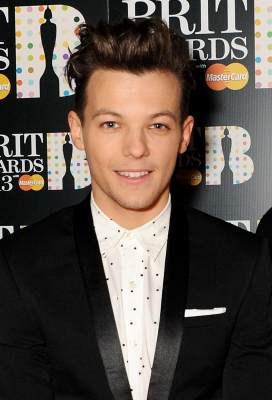 Louis Tomlinson of One Direction arrive at the BRIT Awards 2013 at the O2 Arena, London, on February 20, 2013