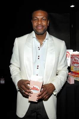 Chris Tucker plays Mattel Games' Pass the Popcorn! Game for charity