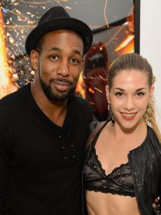 Stephen &#8216;tWitch&#8217; Boss and Allison Holker attend Tyler Shields debut of MOUTHFUL presented by A/X Armani Exchange in support of LOVE IS LOUDER at a privates Studio in Los Angeles on May 19, 2012 