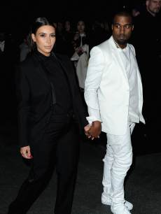 Kim Kardashian and Kanye West are spotted holding hands at the Givenchy Fall/Winter 2013 Ready-to-Wear show in Paris on March 3, 2013