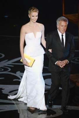 Charlize Theron and Dustin Hoffman present onstage during the Oscars held at the Dolby Theatre in Hollywood on February 24, 2013