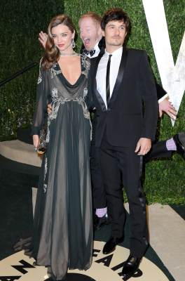 Miranda Kerr and Orlando Bloom get photo-bombed by 'Modern Family's Jesse Tyler Ferguson at the 2013 Vanity Fair Oscar Party at Sunset Tower on February 24, 2013 in West Hollywood, Calif.